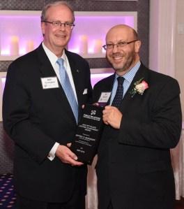 Receiving PRPLI's Lifetime Acheivement Award from Bert Cunningham (l.)